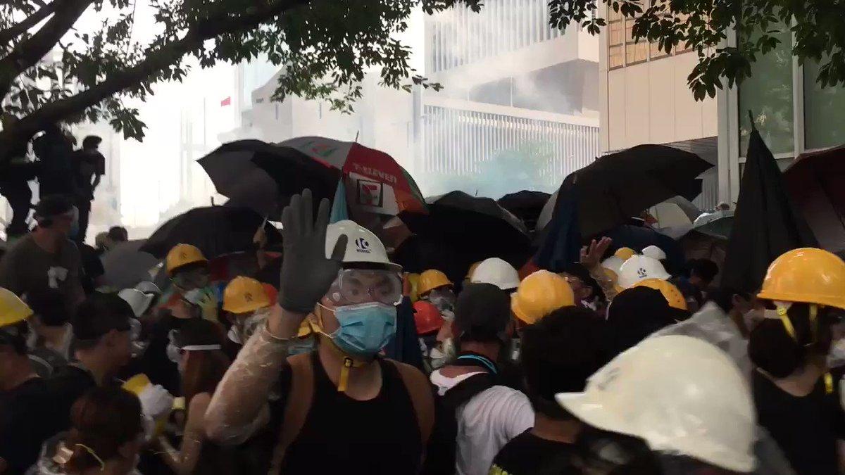 Frantic retreat now ; tear gas burning