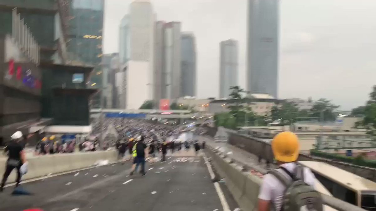 'Do it!' Photographer who taunted Hong Kong police during protests goes viral