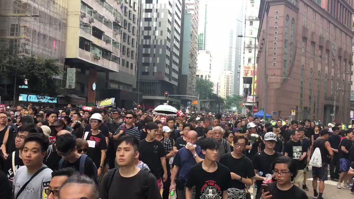 """A record is playing on loop to protesters passing through Wan Chai saying: """"Vicious woman Carrie Lam ordered the shooting of protesters and has violently suppressed the will of 1.03 million Hong Kongers. Carrie Lam step down.""""  👉 In full: http://bit.ly/extraditionhk"""