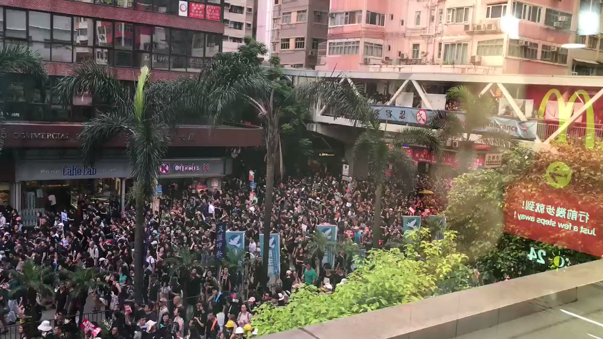 Turnout seems clearly in the hundreds of thousands in Hong Kong. It was a thick slow crawl like this in Wan Chai for more than an hour.