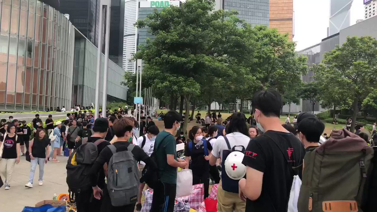 Protesters against the #HK #ExtradictionBill turn to gather at the Tamar Park near LegCo - some take a rest, some organise and stack up their materials. They say they're waiting for more people to join them later.