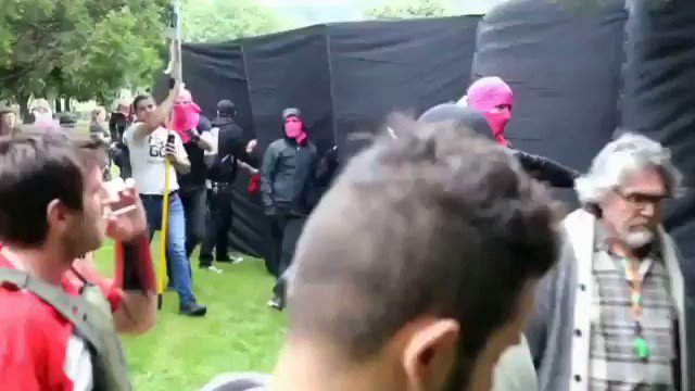 This man's cigarette didn't even fall while clashing and bashing into Antifa!  Smoking is bad for your health  but that guy looked cool   Make sure you turn up the volume!
