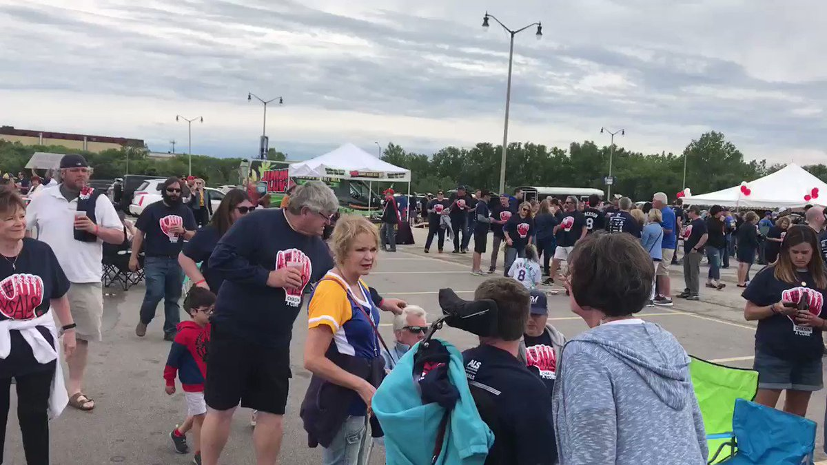 About a thousand people have joined the ALS Chasin' A Cure Tailgate. All of the money raised goes to helping patients in Wisconsin. #vsALS