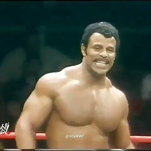A young @TheRock watching his pops, Rocky Johnson...