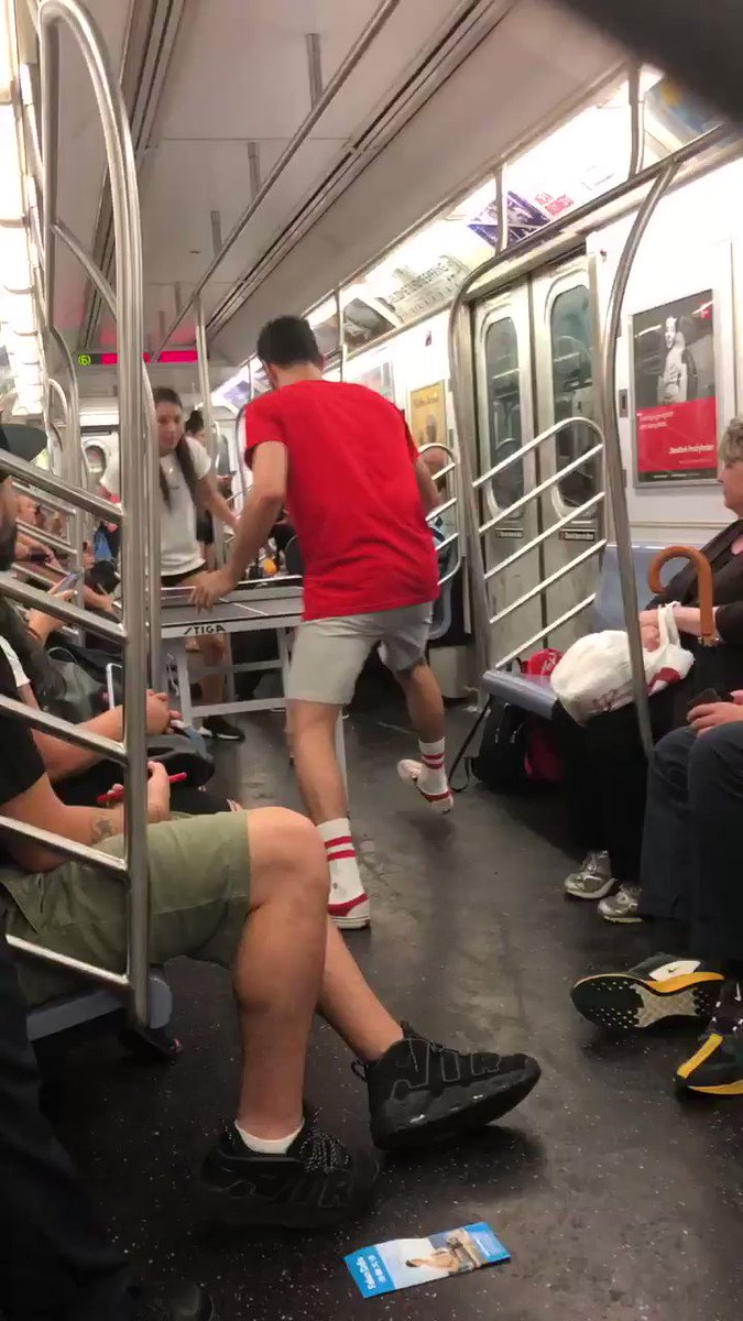 On the 6 train tonight, a couple takes a table out and starts a ping pong game....#I❤️NYC