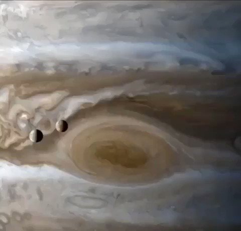 How stunningly ethereal is this!? 😍 Io and Europa float through space along their orbits, past Jupiter's giant red spot, in a video created by using still images taken by Cassini.  📷: NASA/JPL/Kevin M. Gill