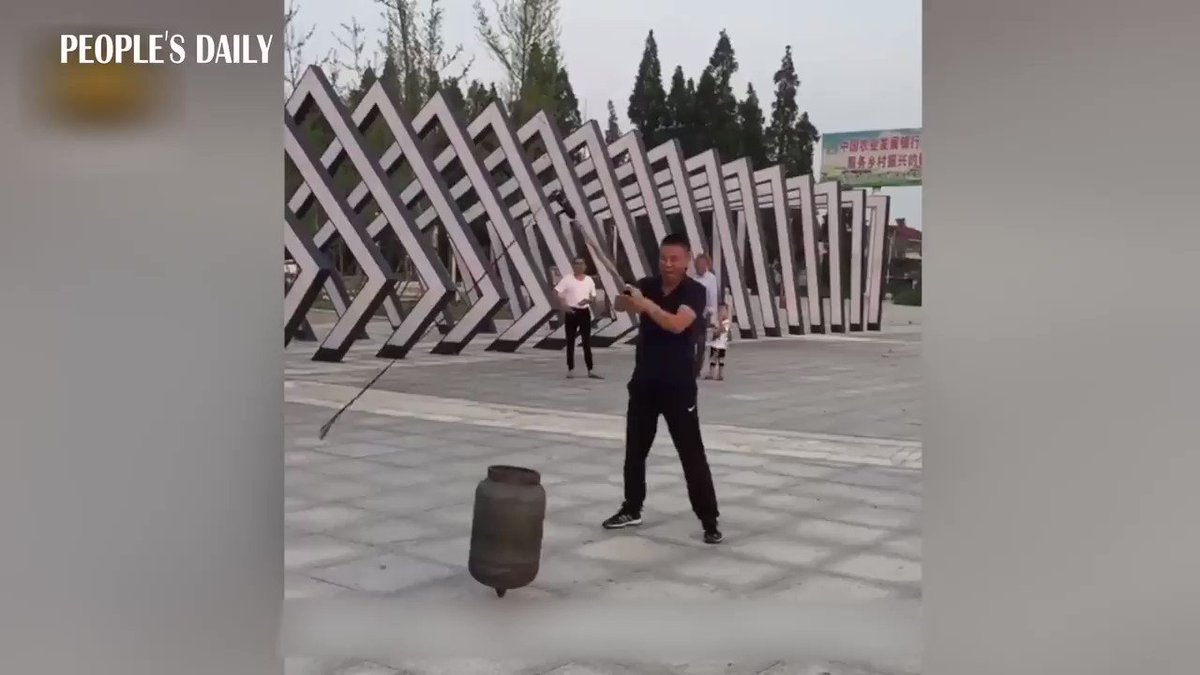 Chinese uncles take spinning top to another level: gas tank! #kungfu