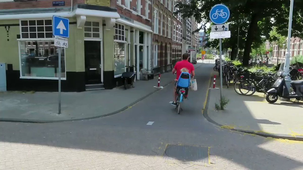 This street in Amsterdam used to be open to cars and have car parking on it. Now it is a cycle only street, with more bike parking and a larger children's playground