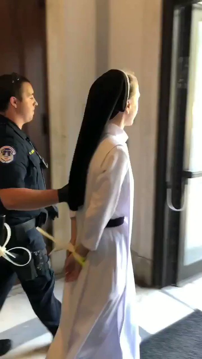 Image for the Tweet beginning: Catholic Nun led out of