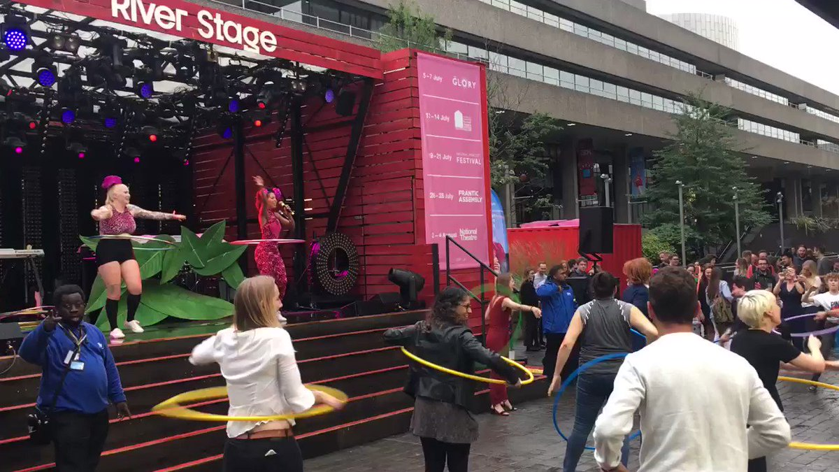 Mass hula-hooping on the @NationalTheatre River Stage to kick start the #London #NationalParkCityFestival.#NationalParkCity hula-hooping in all weathers!!!