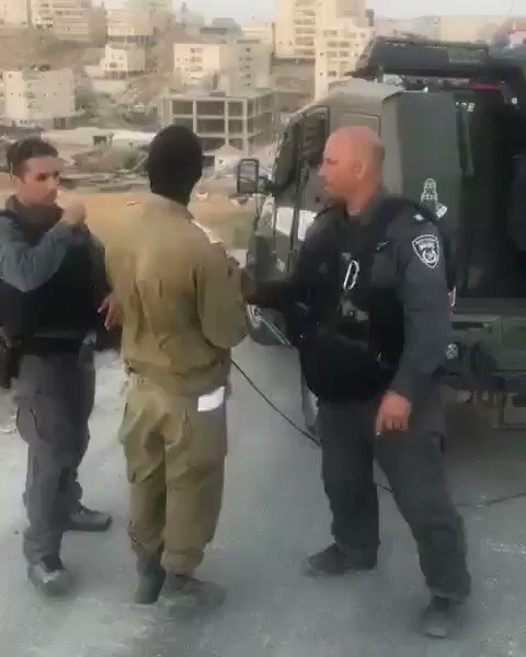 You won't see this on western media!  Israeli soldiers celebrate and cheer as they blow up a Palestinian house in Jerusalem today.