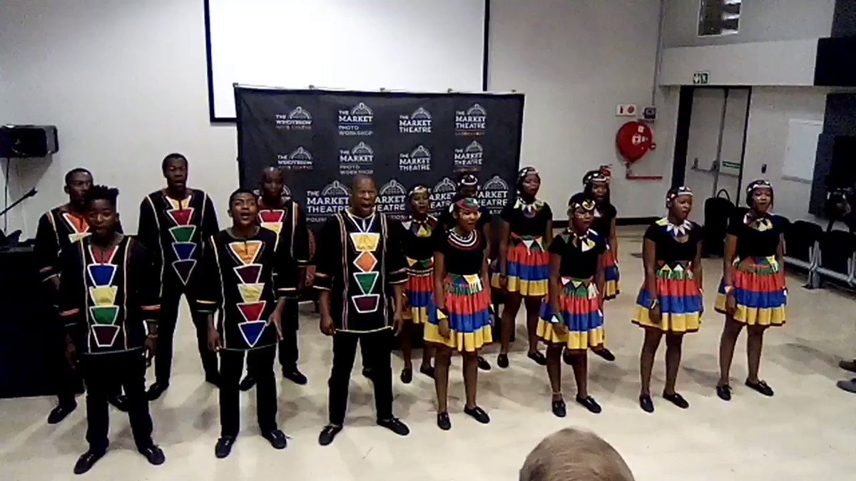 Minister Nathi Mthethwa also joins in song and dance while the @ChoirAfrica perform for him, this morning at the Market Photoworkshop auditorium