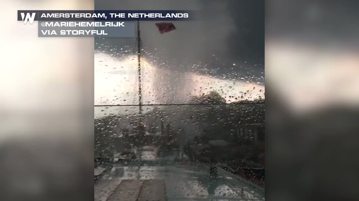 Whoa!!! A suspected landspout ripped through Amsterdam today, whipping up debris and water, and causing damage to trees and buildings there. Heres how that translates on video!