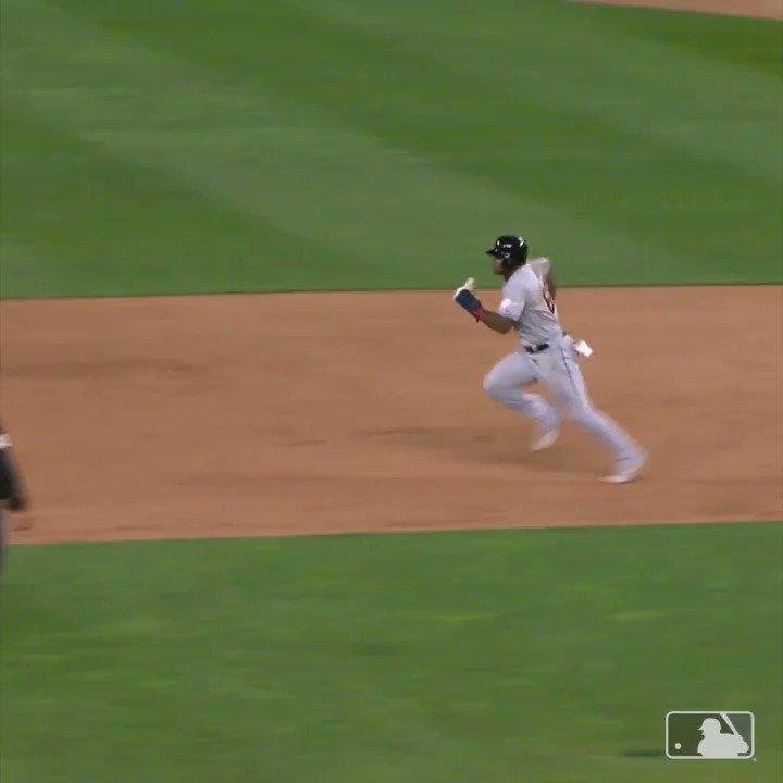 Yasiel Puig waves to Twins on bases
