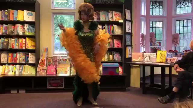 """Library story hour event in Devon, England:  Transvestite """"Mama G"""" explains and demonstrates before an audience of small children how to twerk.  Numerous parents have spoken out against the performance, calling it alarming, inappropriate and confusing."""