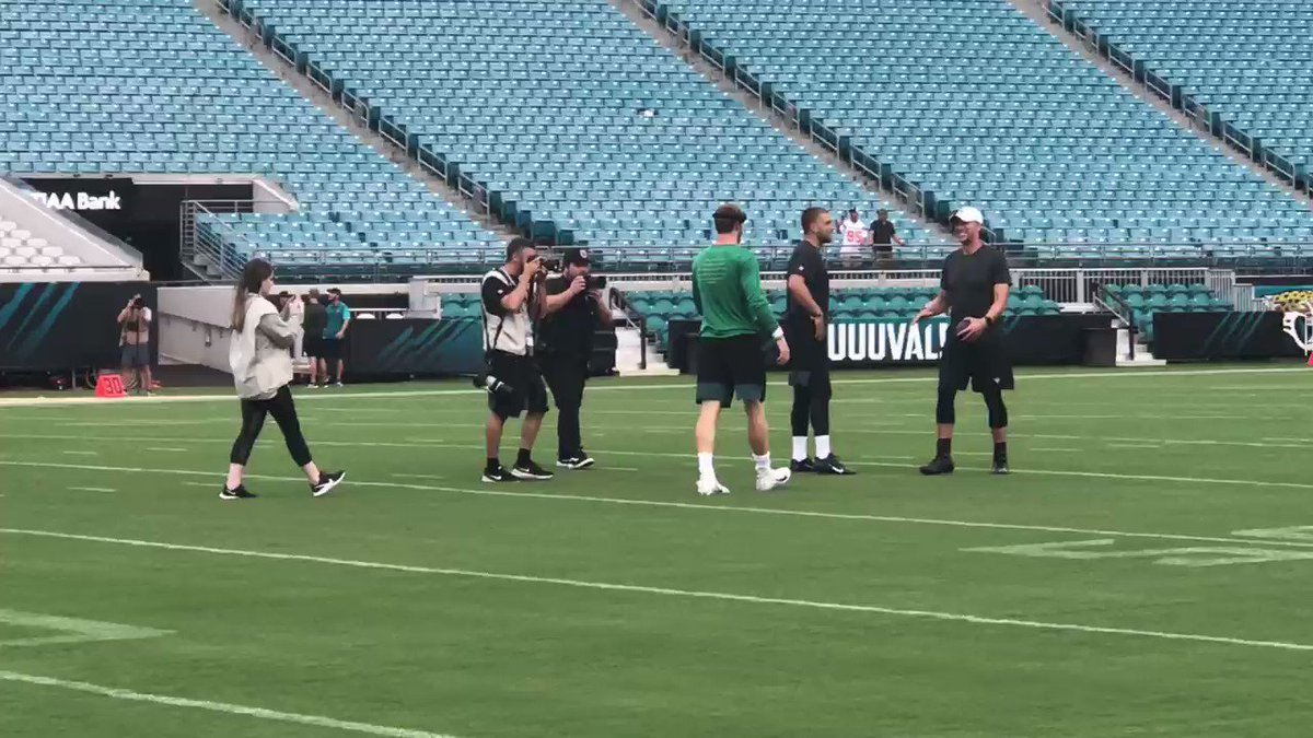 The current franchise QB walks across the field to embrace the former Super Bowl MVP.