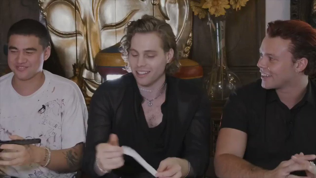 calum built a tiny paper airplane and played with it while they were doing a q&a, this is the man youre all intimidated by?