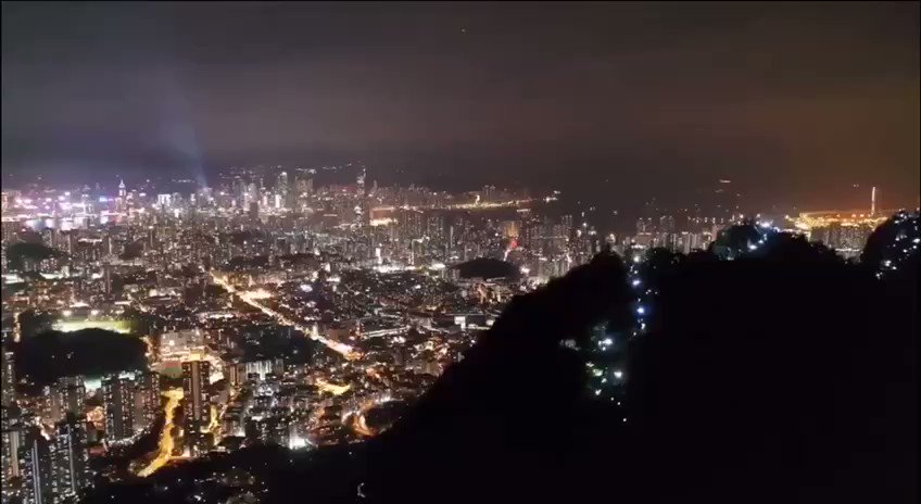 The lights sparkling across the mountains surrounding Hong Kong are the human chain of protesters. #TheHongKongWay protest was a 28 mile human chain of protest last night.