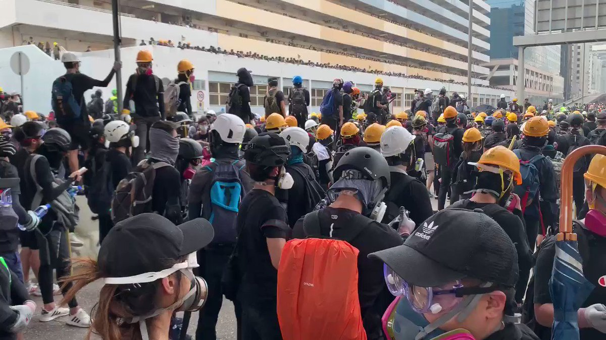 A #HongKongProtests reality. The more black the protestors wear, the more aggressive they are. And this is the most black I've seen in the crowds since last Sunday's peaceful mass rally that 1.7 million people attended. @CBSNews is here. #KwunTong #HongKongpic.twitter.com/8mY14SSXKH