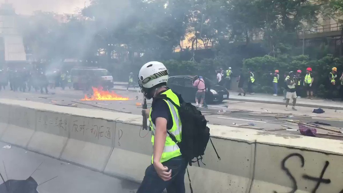 Hong Kong police fire tear gas in renewed clash with protesters