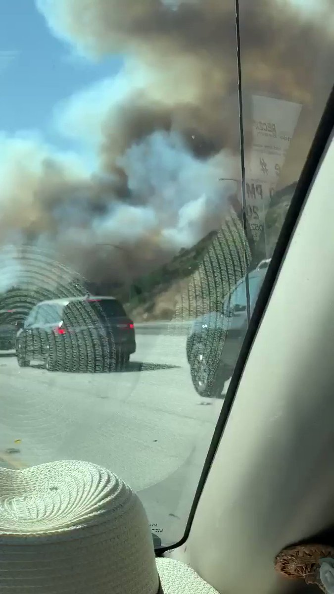 Brush fire burning in Eagle Rock, clogging freeways and moving toward homes