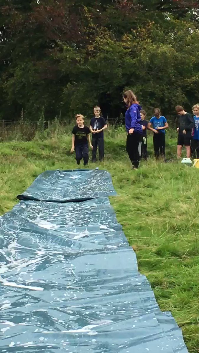 Early attempts at the Tir-y-Cwm water slide.  Water and mud.  What more could the boys want? #tycadventure