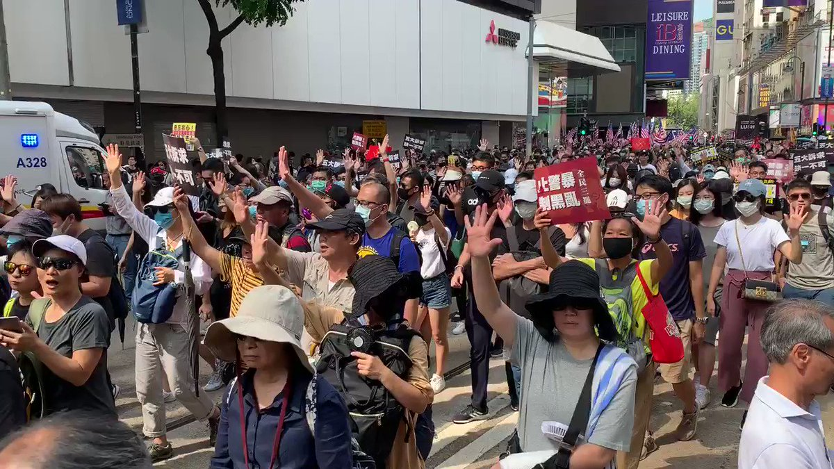 """And we are walking down Hennessy road - five fingers are for the five demands - protesters call for """"not one less"""" as leader Carrie lam has only met one so far"""