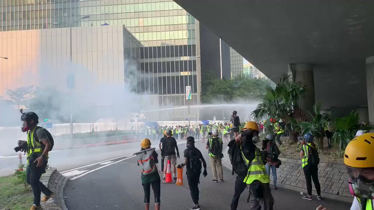 Water cannon hit by petrol bomb and caught on fire. #antielab #hongkongprotests