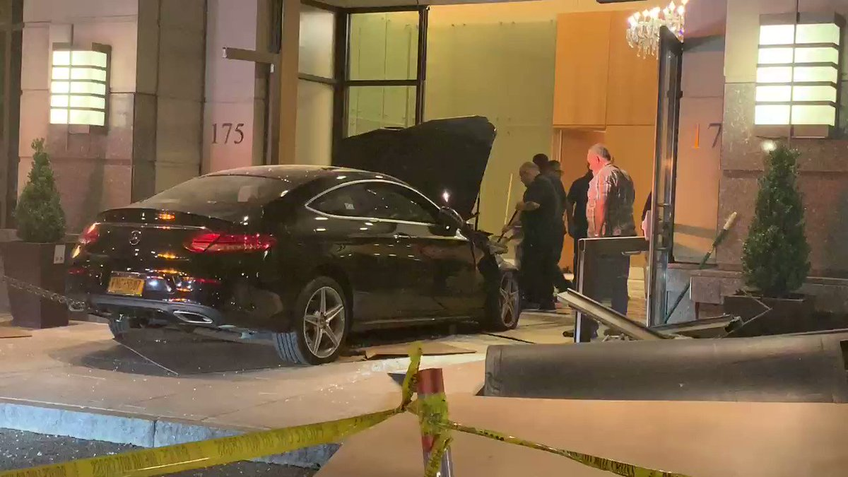 Nice black Mercedes about to be towed from lobby of Trump Plaza in New Rochelle, Westchester County. Police say crash appears to be accidental, but they are investigating @CBSNewYork