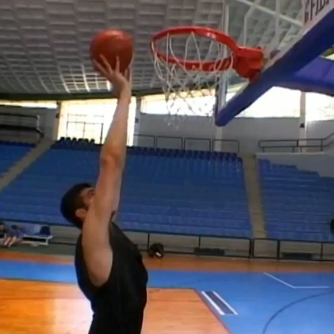Would this be offensive goaltending in a game? 77 Slavko Vraneš forcing in a 2 hand dunk flat footed.