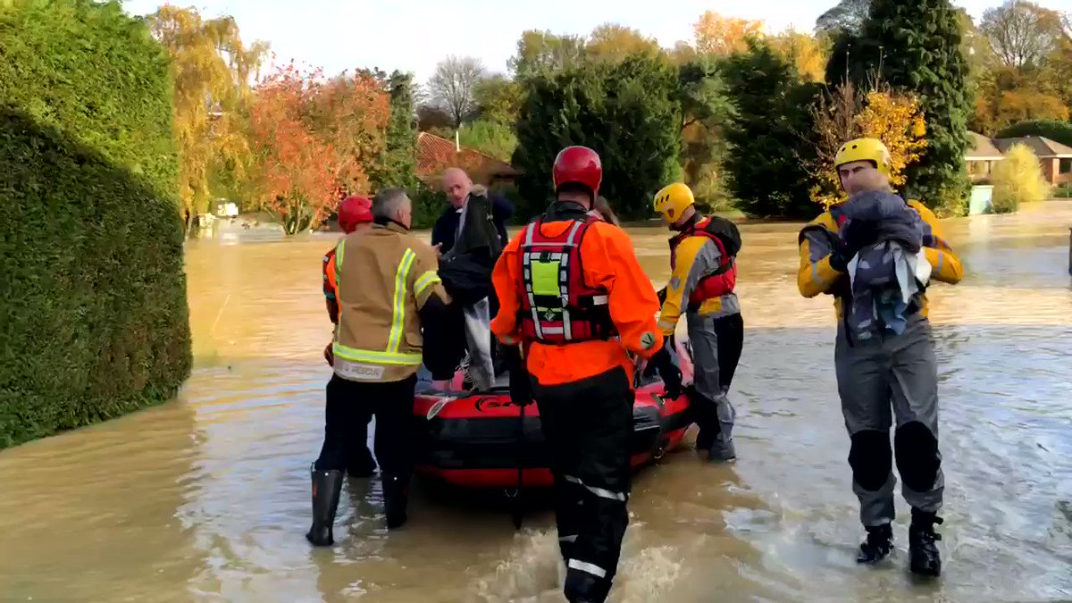 The Calvert family being rescued by firefighters in Scotter #lincolnshire #flooding
