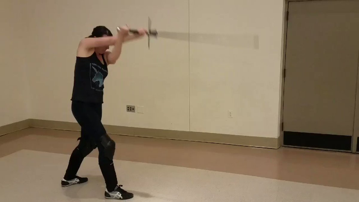 Warming up for sword fighting where library staff weild more than just information