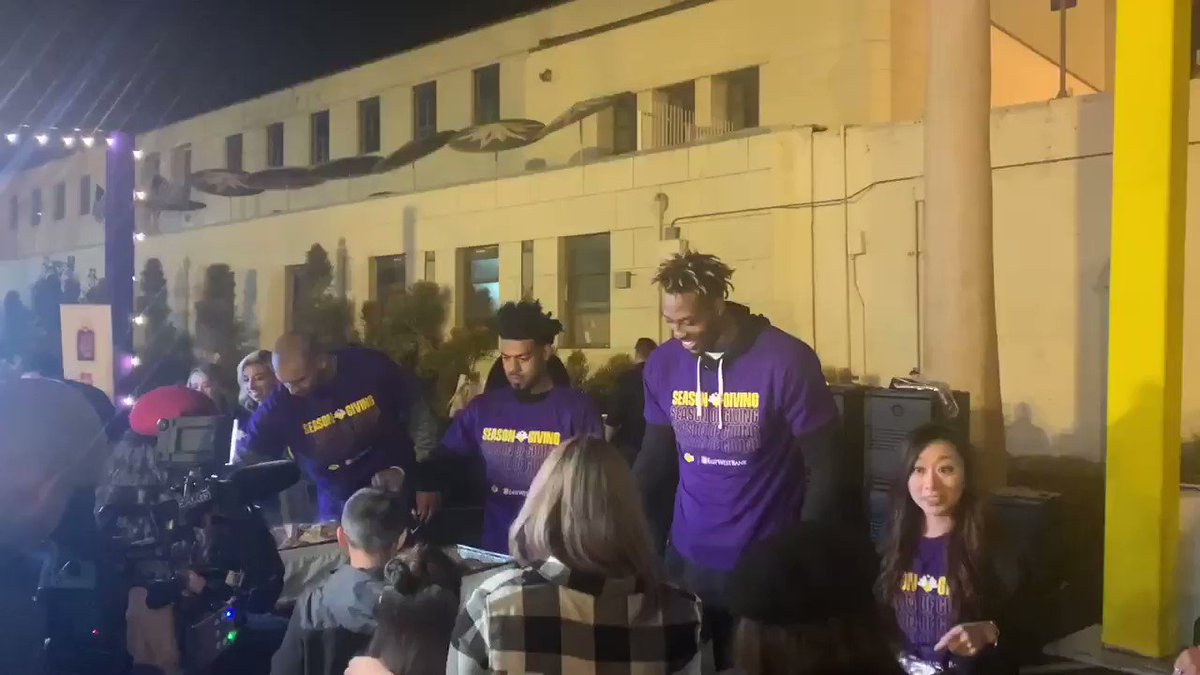 Dwight Howard, Jared Dudley, and Quinn Cook serving Thanksgiving meals to the guests. Also, Dwight learns what a beret it.