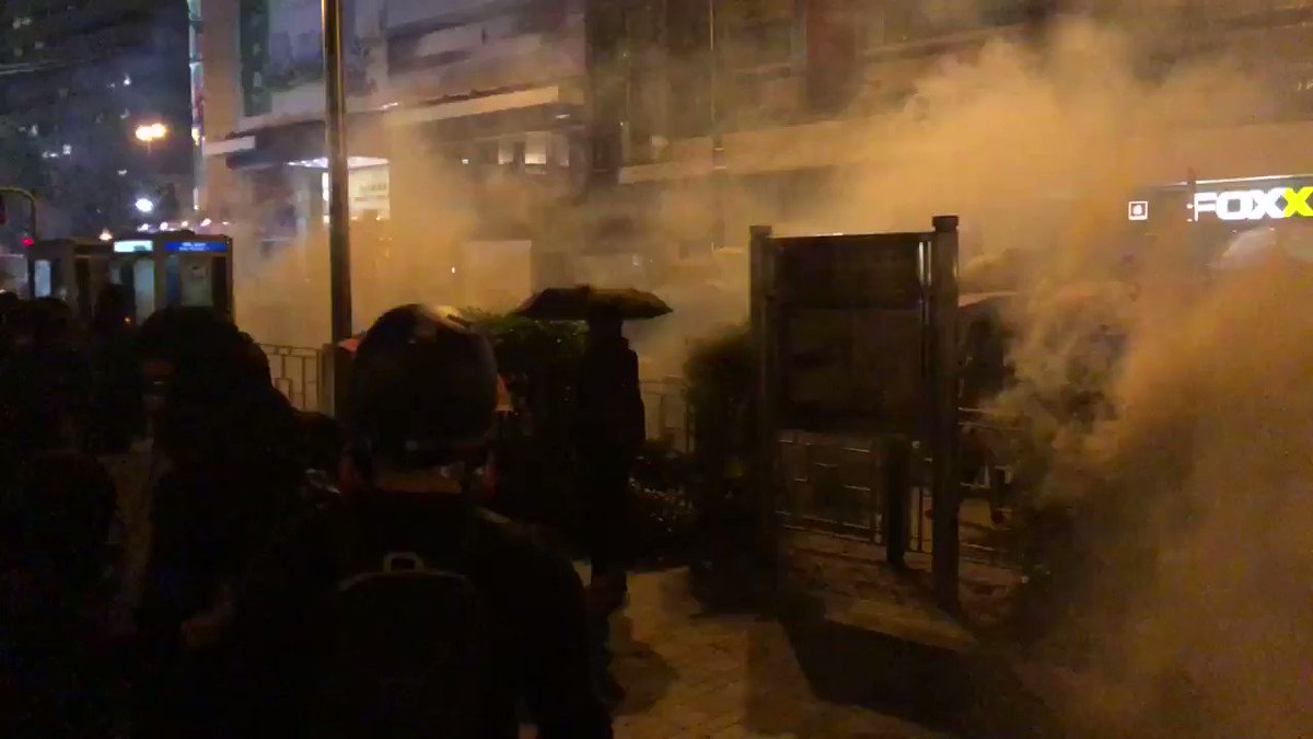 Protester front line advances through clouds of tear gas towards police