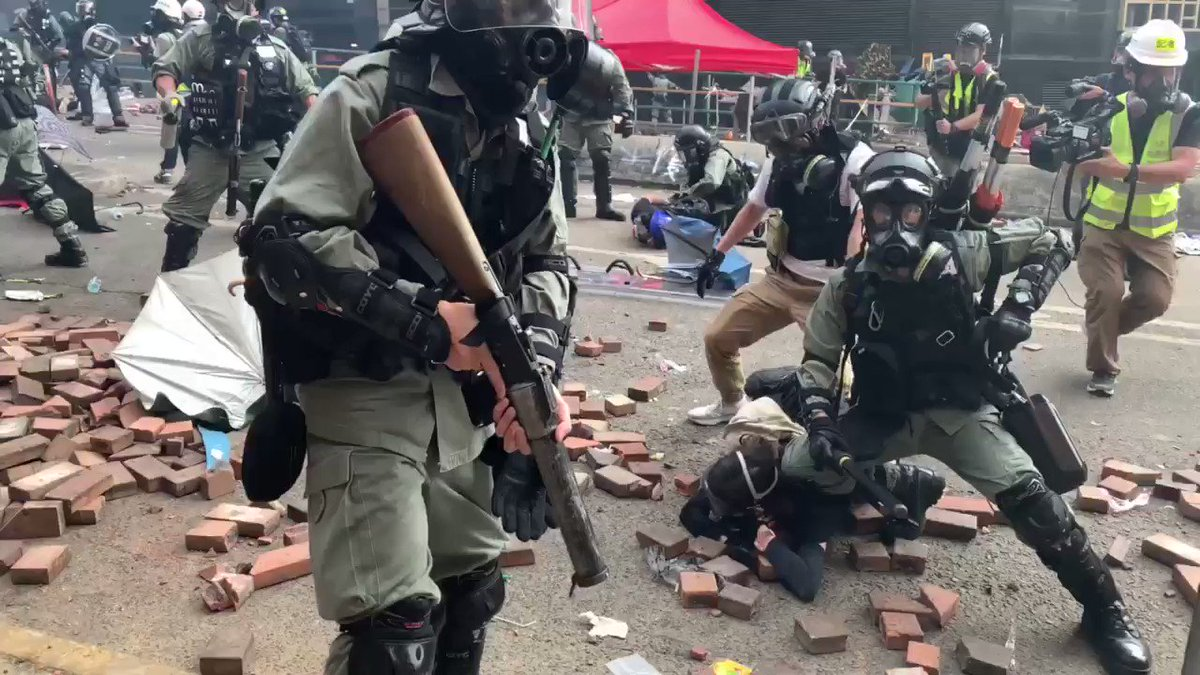 Breaking: Riot police move in hard and rain tear gas and projectiles on trapped #PolyU protesters who, for a second time, tried but failed to get free #HK #HongKongProtests #AntiELAB #China