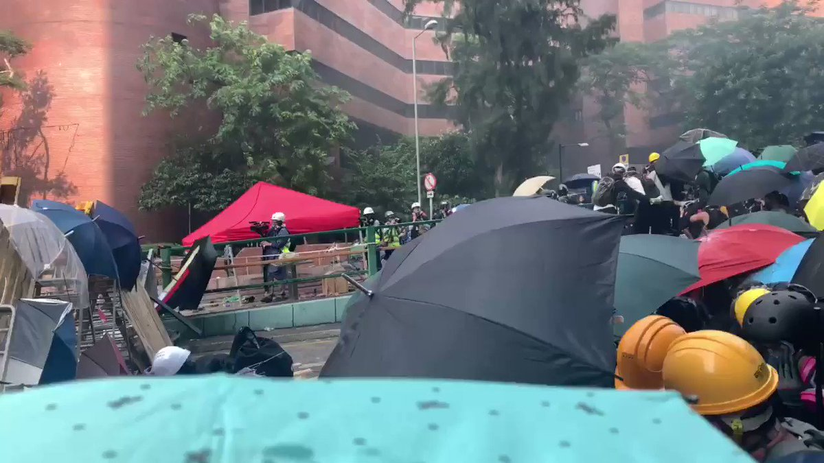 Breaking: #PolyU protester umbrellas ripped and shredded by high velocity projectiles from riot police in chaotic scenes. Wedged in, the assault triggered a stampede to safety with some students falling, tripping, tackled to the ground and hit #HK# HongKongProtests #China