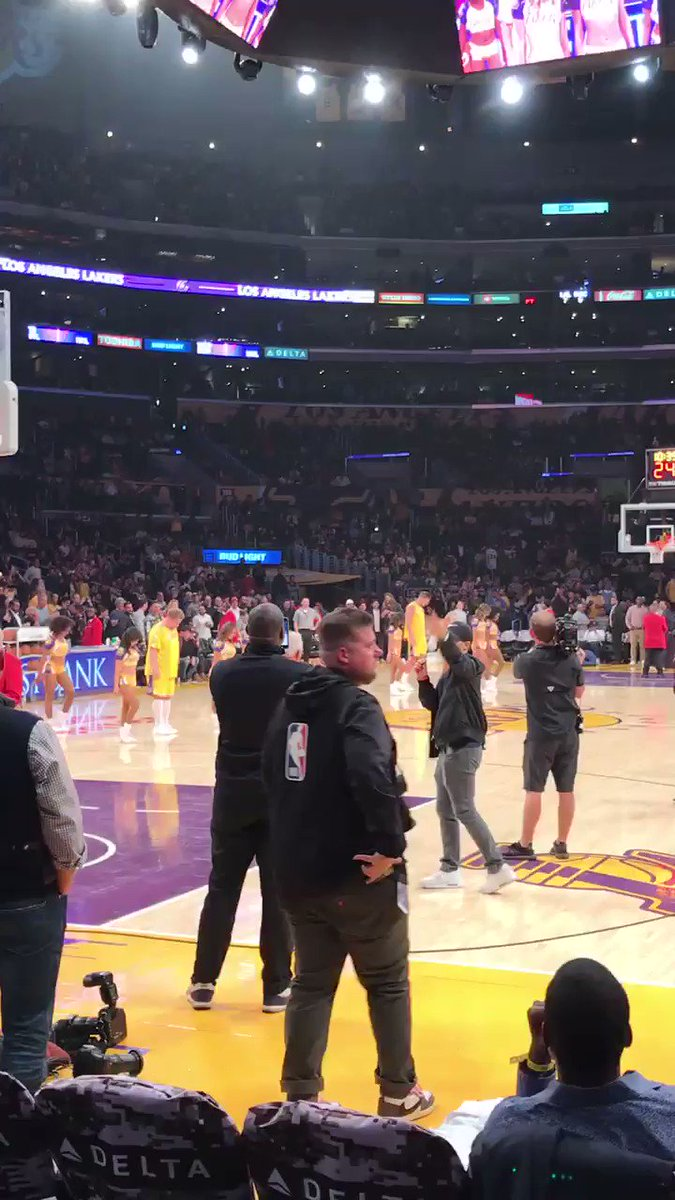 Here's Rob Gronkowski and James Corden dancing with the Laker girls at halftime.