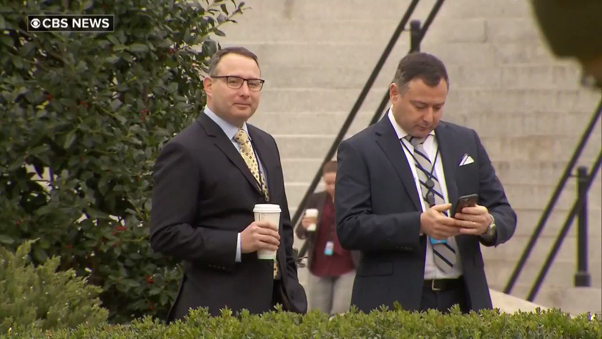Exclusive: Our sharp @CBSNews photographer captured a good spirited Lt. Col. Alexander Vindman returning to work after testifying in #ImpeachmentHearings. Here, Vindman is with his twin brother clearly wanting to be seen as they take a selfie in front of the West Wing.
