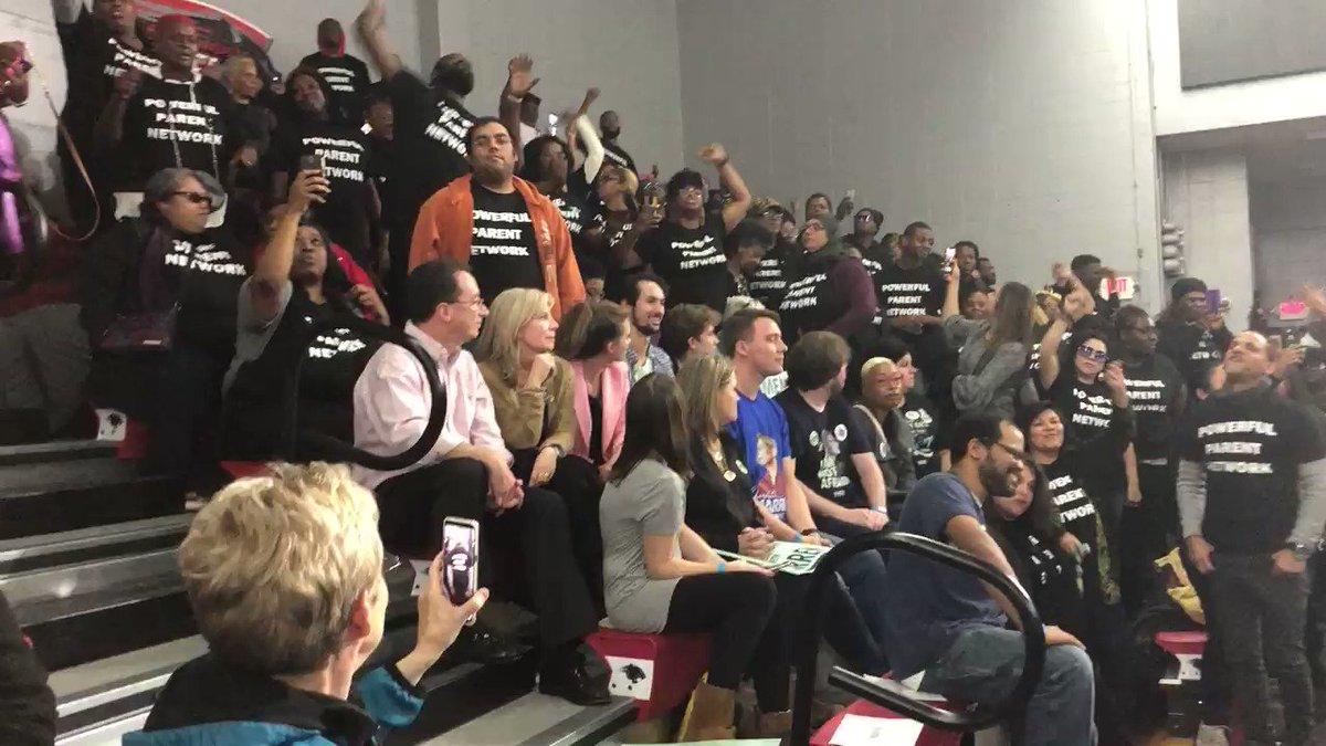 Image for the Tweet beginning: Pro-charter school protesters disrupt @ewarren