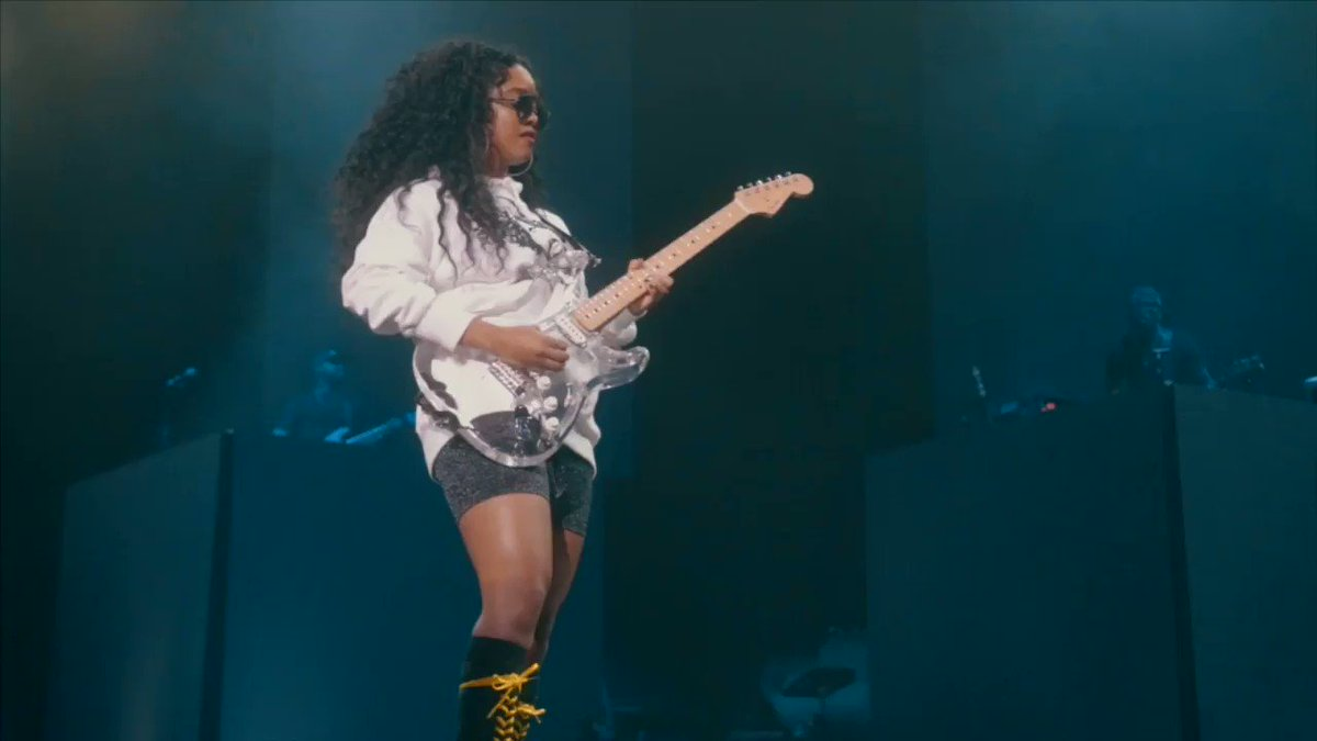 We caught award nominated @HERMusicx at the @LightsOnFest killin it on her clear guitar 😍 Check out our recap video from her first ever #LightsonFestival: bit.ly/2KJd8bc