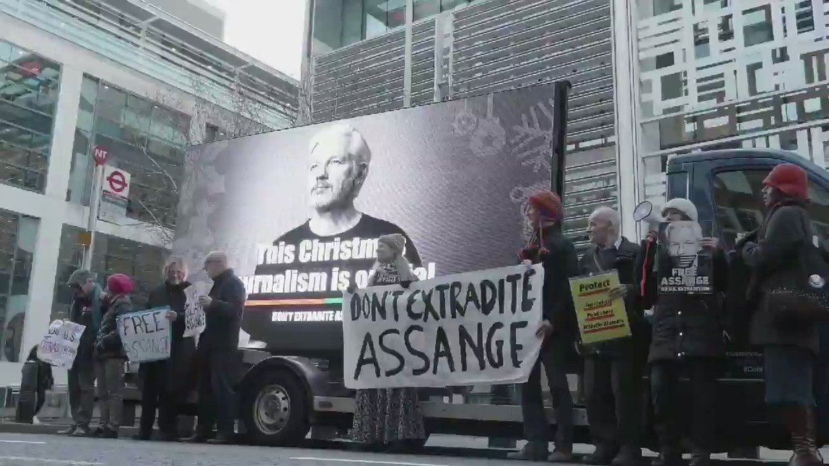 """Brian Eno: """"I'm here because what's happening to Julian Assange is completely immoral... If you support this case, get these postcards from the Don't Extradite Assange website. This is important not just for Assange but for the future of journalism."""" https://t.co/U0wQPiecWo"""