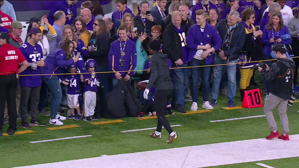 Stefon Diggs playing catch with two young fans repping his jersey. #FootballisFamily