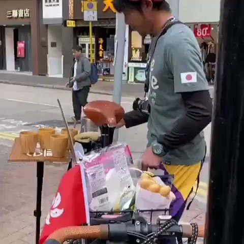 """My heart aches when I know what's happening in #HongKong these days. I bring some coffee from #Japan to warm you up! It's free. Everyone enjoy!""   Giving #HKCitizens a bit of warmth & support. A #Japanese tourist decided to set up a mobile coffee giveaway stall in #Wanchai."