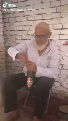 """An elderly #Uyghur man is forced to drink #alcohol to prove that he is not a """"religious extremist."""" The #Uighurs are a Turkic ethnic group who are predominantly #Muslim. Drinking alcohol is forbidden in #Islam; however, #China has effectively banned Islam in #EastTurkistan."""