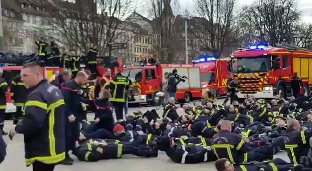 Protests are sweeping France.  They were sparked by the government messing with people's pensions. But they've grown into something much bigger.  Now, firefighters are joining in by lying in the streets.