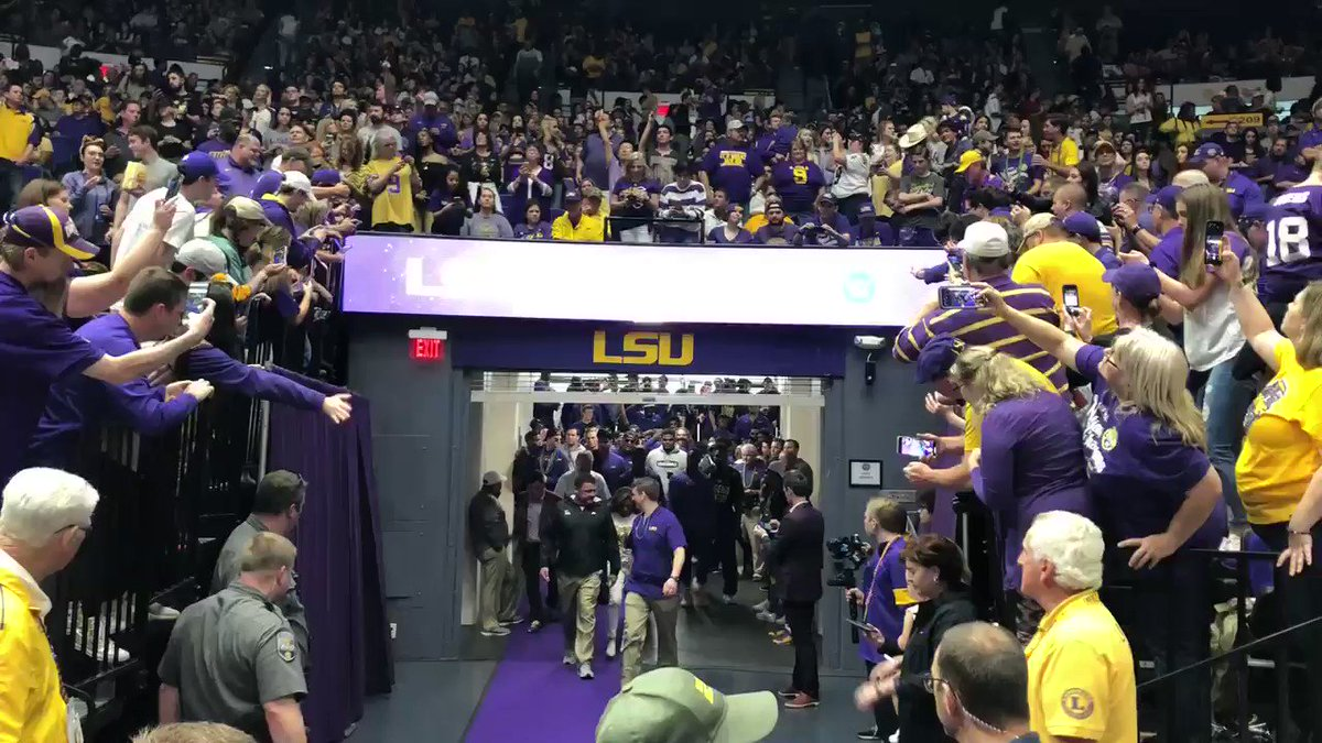 Ed Orgeron and the #LSU football team enters a packed PMAC.