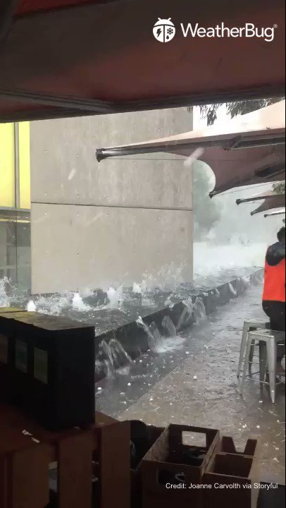 A group of workers having lunch at a Canberra cafe took cover under an umbrella as a severe hailstorm smashed the Australian capital on January 20.  📍Canberra, Australia  #WeatherBug #knowbefore #wx #weather #hailstorm