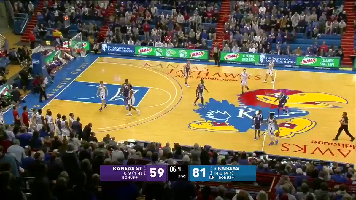 Benches emptied at the end of the Kansas State-Kansas game.