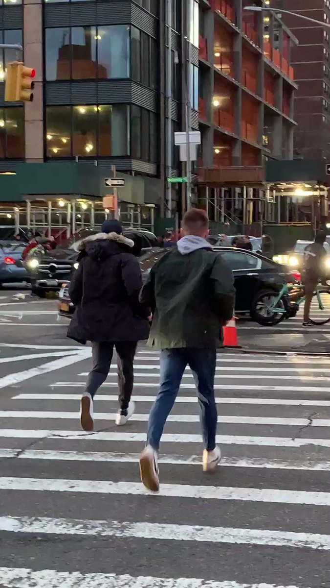 Manhattan Bystanders Lift SUV to Free Trapped Woman