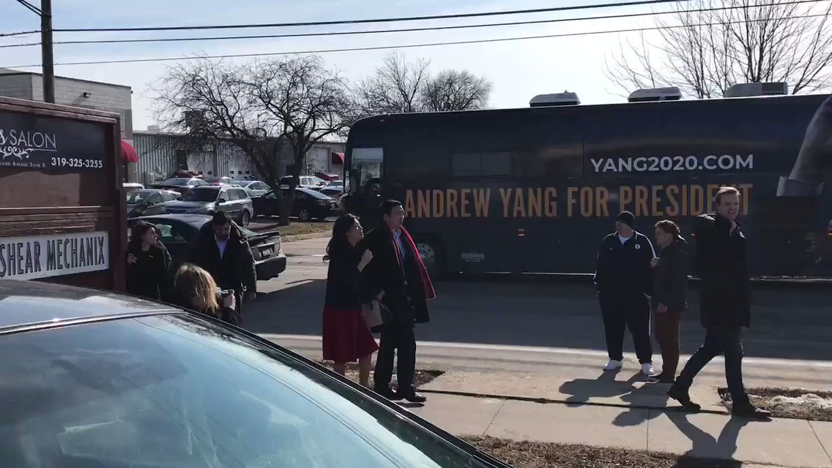 """The @AndrewYang team comes in as crowd chants """"Andrew Yang!"""""""